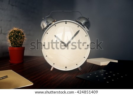 Glossy alarm clock on wooden desktop with cactus, calculator and other items. 3D Rendering - stock photo