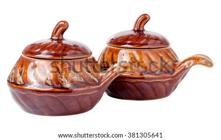 Glossy ceramic pots for cooking isolated on white background - stock photo
