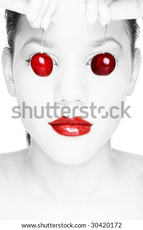 Glossy face of a sexy woman with red color lipstick and cherries instead of eyes, - stock photo