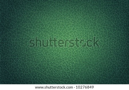 Glossy green Leather spotlit, suitable as a background texture. - stock photo