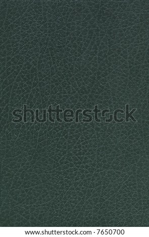 Glossy green Leather, suitable as a background texture. - stock photo