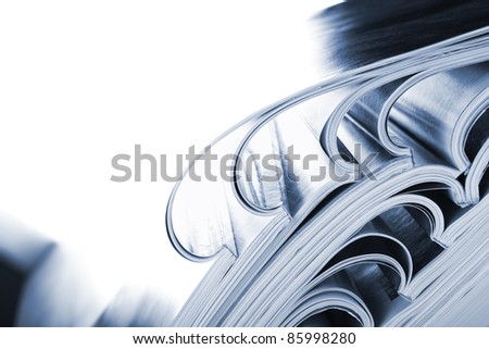 glossy magazines, high key for effect. - stock photo