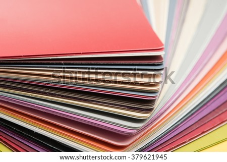Glossy PVC plastic cards to select the color of furniture lined fan close-up on a white background - stock photo