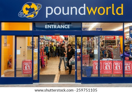 GLOUCESTER, UK - DECEMBER 04: unidentified woman leaving Poundworld store on December 04, 2011 in Gloucester, UK. Founded in 2004, Poundworld maintains over 270 stores and over 5000 employees. - stock photo