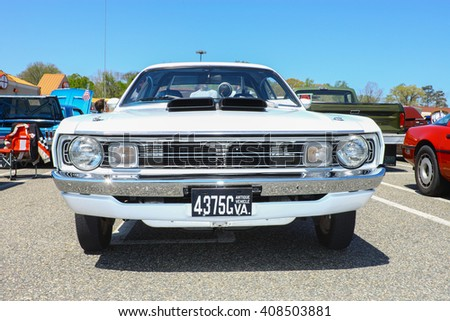 GLOUCESTER, VA - April 16, 2016: A Dodge Dart Demon 340 at the Daffodil car show with different lighting, the Daffodil car show is held once each year after the  Daffodil parade and festival. - stock photo
