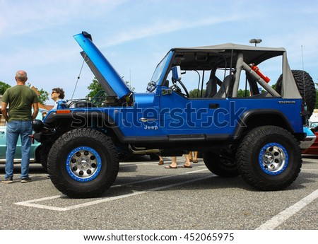 GLOUCESTER, VA - JULY 9, 2016: A Chevrolet powered Jeep Wrangler at the Collector Car Appreciation Day Car Show sponsored by the Middle Peninsula Classic Cruisers car club.