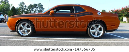 GLOUCESTER, VA- JULY 26: A Dodge Challenger in the 17th Annual 2013 MPCC(middle peninsula car club)meeting at the Main St shopping center in Gloucester, Virginia on July 26, 2013  - stock photo