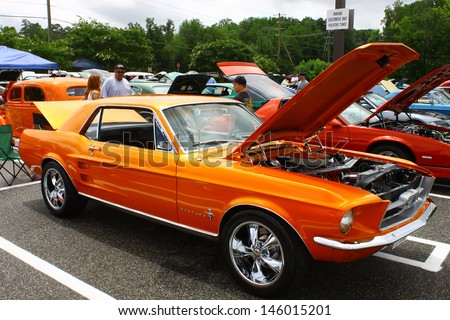 GLOUCESTER, VA- JULY 13: A 67 Ford Mustang in the (middle peninsula car club) blast from the past car show at the Main St shopping center in Gloucester, Virginia on July 13, 2013 - stock photo