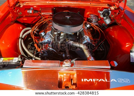 GLOUCESTER, VA - MAY 28, 2016: A red 1965 Chevrolet Impala SS 396 motor at the First Aaron's rental car and Motorcycle show, the show is Sponsored by Aaron's furniture rental of Gloucester - stock photo