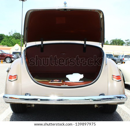 GLOUCESTER, VA- MAY 25: Ford Deluxe trunk in the (middle peninsula car club) relay for life car show at the Main St shopping center in Gloucester, Virginia on May 25, 2013 - stock photo