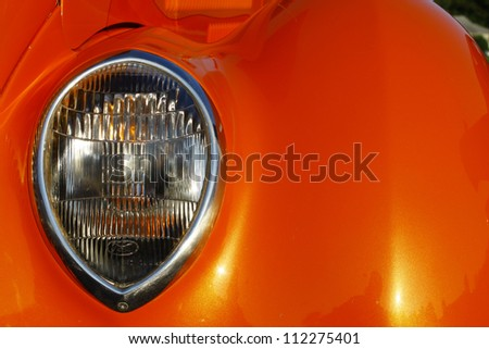 GLOUCESTER, VA- SEPTEMBER 7:A 1936 Ford tudor headlight at the 23rd Annual 2012 MPCC(middle peninsula car club)meeting at the Main St shopping center in Gloucester, Virginia on September 7, 2012. - stock photo