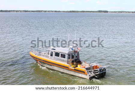GLOUCESTER, VA - SEPTEMBER 6, 2014: A US Coast Guard marine patrol boat cruising and patrolling the York river and Chesapeake bay in Yorktown Virginia on a summer day - stock photo