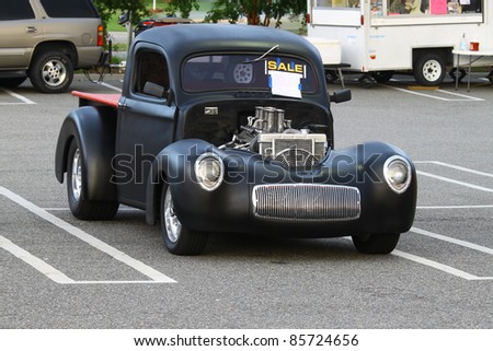 GLOUCESTER, VA, USA -SEPTEMBER 30: A vintage 1940 Willy's pickup on display in the Middle Peninsula Classic Cruisers Club weekly Car Show at the Main Street Center on September 30, 2011 in Gloucester, VA, USA - stock photo