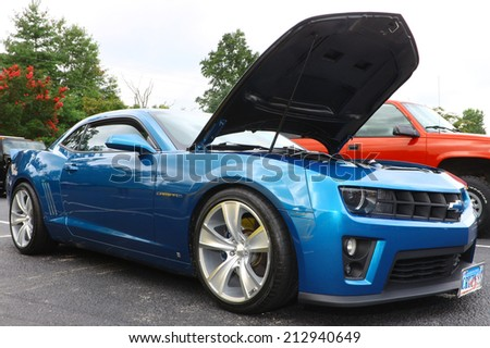 GLOUCESTER, VIRGINIA - AUGUST 23, 2014:A Blue Chevy Camaro in the DRIVE-IN FOR DIABETES CAR SHOW Sponsored by Tractor Supply in August in Gloucester Virginia. - stock photo