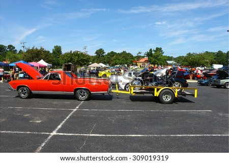 GLOUCESTER, VIRGINIA - AUGUST 22, 2015:A Chevy ElCamino trailering a Honda Gold Wing in the DRIVE-IN FOR DIABETES CAR SHOW Sponsored by Tractor Supply in August in  Gloucester Virginia.