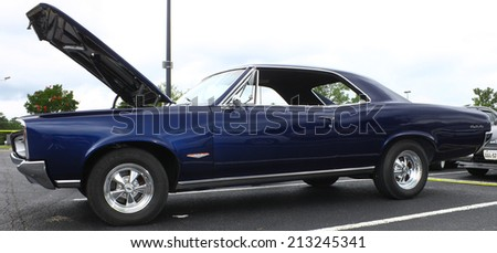 GLOUCESTER, VIRGINIA - AUGUST 23, 2014:A Pontiac GTO, also known as a Goat in the DRIVE-IN FOR DIABETES CAR SHOW Sponsored by Tractor Supply in August in Gloucester Virginia. - stock photo