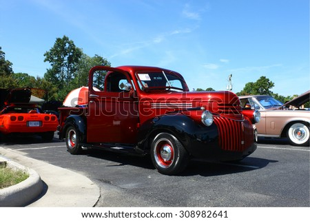 GLOUCESTER, VIRGINIA - AUGUST 22, 2015:A 1941 red Chevrolet truck in the DRIVE-IN FOR DIABETES CAR SHOW Sponsored by Tractor Supply in August in Gloucester Virginia. - stock photo