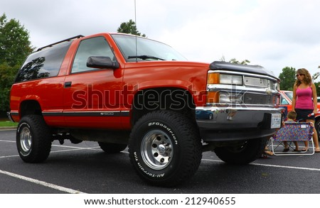 GLOUCESTER, VIRGINIA - AUGUST 23, 2014:A red 1995 Chevy Blazer in the DRIVE-IN FOR DIABETES CAR SHOW Sponsored by Tractor Supply in August in Gloucester Virginia. - stock photo