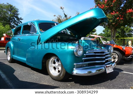 GLOUCESTER, VIRGINIA - AUGUST 22, 2015:A turquoise fat 1948 Chevrolet in the DRIVE-IN FOR DIABETES CAR SHOW Sponsored by Tractor Supply in August in Gloucester Virginia.