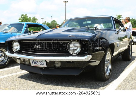 GLOUCESTER, VIRGINIA - JULY 12, 2014: A Black 1969 Chevrolet Camaro SS396 in the Blast from the PAST CAR SHOW,The Blast From the Past car show is held once each year in July in Gloucester Virginia. - stock photo