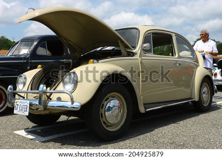 GLOUCESTER, VIRGINIA - JULY 12, 2014: A 1967 Volkswagon Beetle Bug in the Blast from the PAST CAR SHOW,The Blast From the Past car show is held once each year in July in Gloucester Virginia.  - stock photo