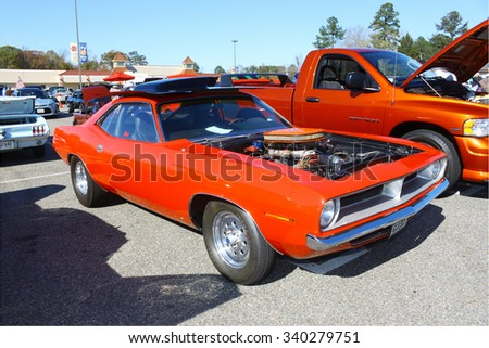 GLOUCESTER, VIRGINIA - NOVEMBER 14, 2015: A Dodge Challenger 440 six pack engine in the annual Shop With a Cop Car Show held once each year to help benefit needy children of Gloucester for Christmas.