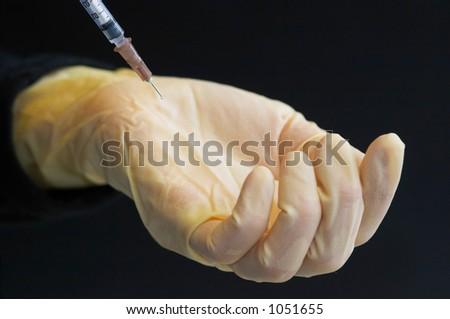 Glove and syringe - stock photo