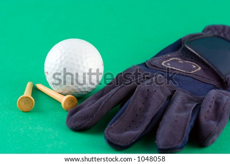 Glove, golf ball and tees - stock photo