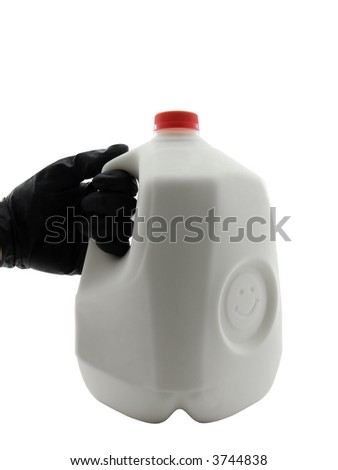 Gloved hand holding a gallon of milk