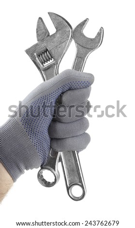Gloved hand holding wrenches isolated on white - stock photo