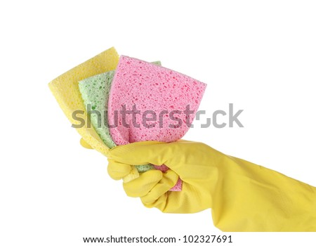 Gloved hand with colorful sponges on white