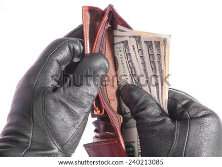 gloved hands with a purse - stock photo