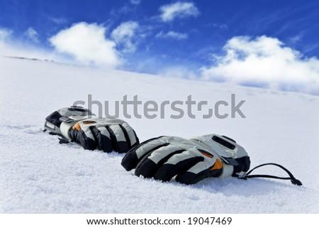 gloves on snow - stock photo