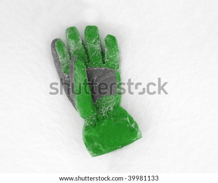 Gloves on snow - stock photo