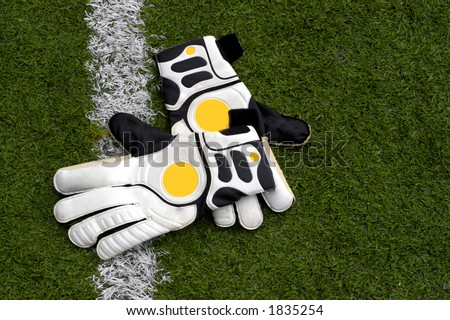 gloves on the field of soccer - stock photo