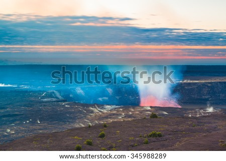 Glow of an erupting volcano at early sunrise at Hawaii Volcanoes National Park