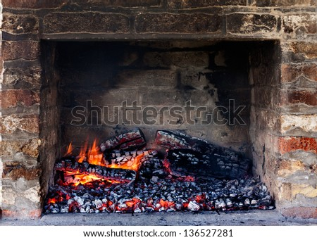 Glow of embers preparing for outdoors charcoal-barbecuing in fireplace - stock photo