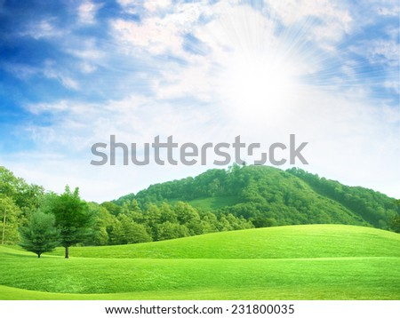 glow solar sky on beautiful meadow - stock photo