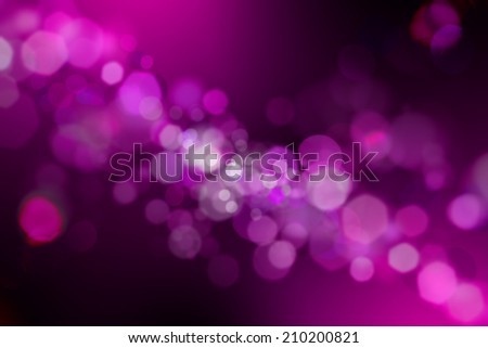 Glowing abstract defocused lights black and purple background  - stock photo