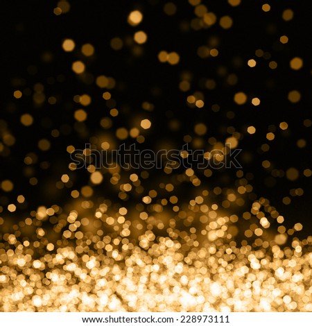 Glowing blurred out of focus lights gold background - stock photo