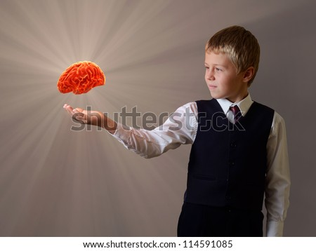 glowing brain of the child hand - stock photo
