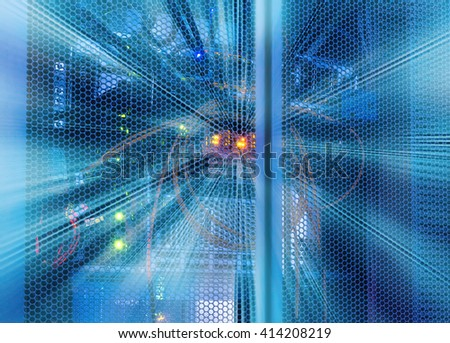 glowing cables in disk storage supercomputer data center - stock photo