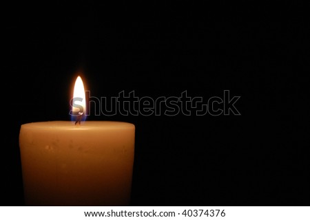 Glowing candle - stock photo