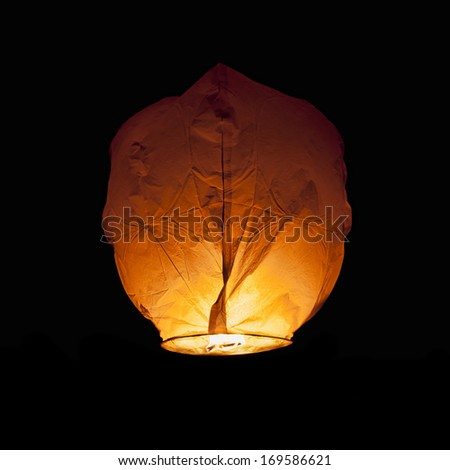 Glowing Chinese Lantern isolated on black