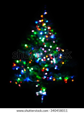 glowing christmas tree on black - stock photo