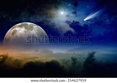 Glowing clouds, full moon rise, stars and comet in dark blue sky. Elements of this image furnished by NASA nasa.gov - stock photo