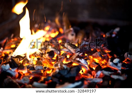 Glowing coals in a barbeque grill - stock photo