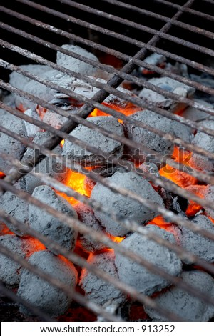 Glowing coals in a barbeque grill