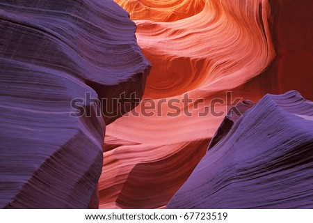 Glowing colorful underground corridor. Famous slot Antelope canyon  in the Navajo reservation. USA. - stock photo