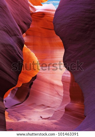 Glowing colorful underground footpath. Famous slot Antelope canyon  in the Navajo reservation. USA. - stock photo